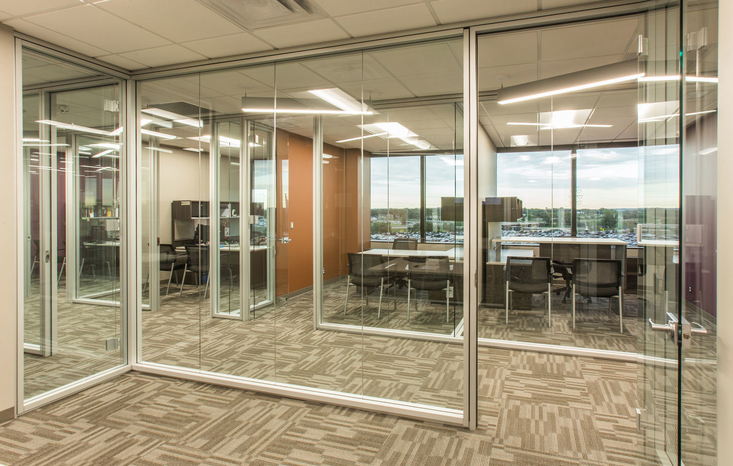 Glass walls enhance the open feel of a space at ISG in Bloomington, Minnesota, furnished by iSpace Environments.