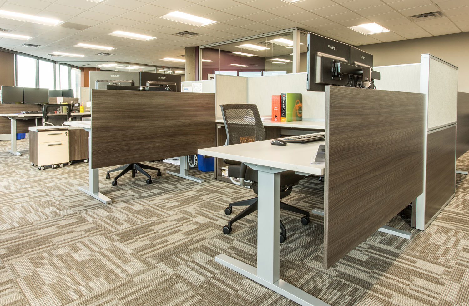 The workstation space layout encourages collaboration and focused work at ISG in Bloomington, Minnesota, furnished by iSpace Environments.