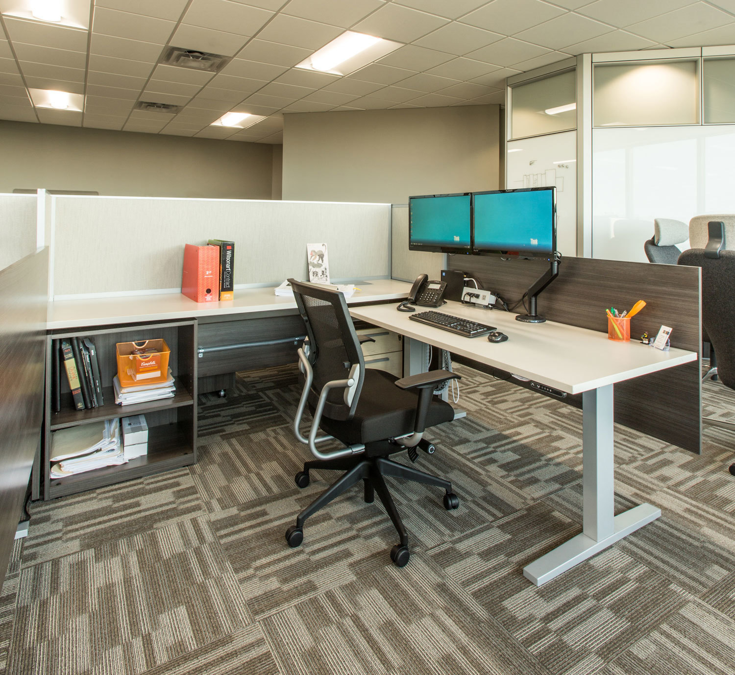 A versatile workstation desk featuring a standing desk at ISG in Bloomington, Minnesota, furnished by iSpace Environments.