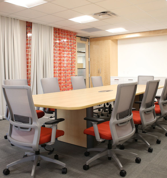 The bright and colorful conference room at the Minnesota Children's Museum offices in St. Paul, Minnesota, furnished by iSpace Environments.