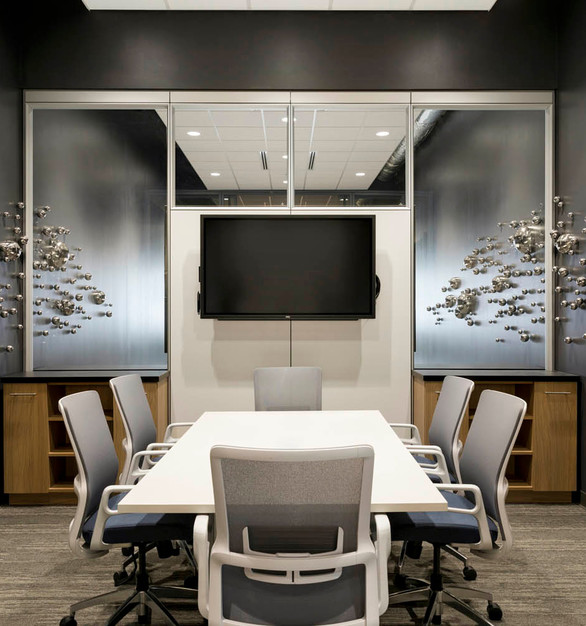 The small conference room with unique wall sculptures that add character to the space at SVL in Roseville, Minnesota.
