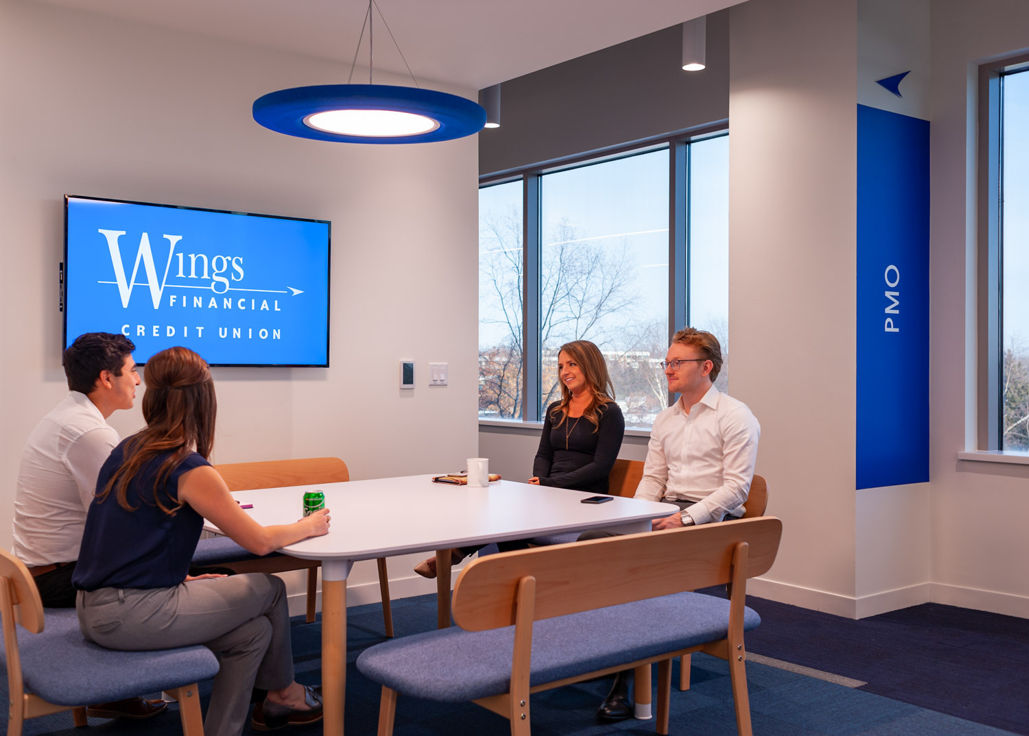 """The focus on flexibility–and employee choice and control–ensured that all 85 dedicated workstations would allow for ergonomic adjustability with height adjustable desks, dual monitor arms and the user friendly Nuovo Contessa task chair from Teknion. Collaboration would now take place in the dedicated workstations or in a variety of styled and sized, open and enclosed meeting rooms. With 2.4 seats per person on the floor, work postures and options are substantial.  Technology upgrades assured that each enabled location operated similarly, minimizing training and troubleshooting setbacks. Utilizing AirMedia to share content wirelessly and Video-Over-IP solutions to link all shared televisions, the opportunity to connect throughout the workplace skyrocketed. Schuenke continues, """"Everyone has laptops and the floor is fully Wi-Fi enabled. The environment fully supports their choice to work anywhere."""""""