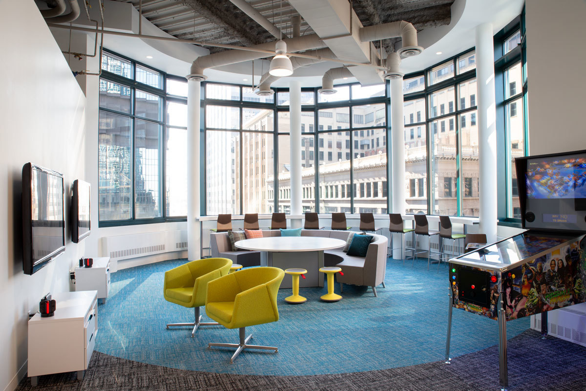 The glass encased turret at the northwest corner of the building encompasses a lounge full of energy including game consoles, social seating arrangements and seated views to the city.