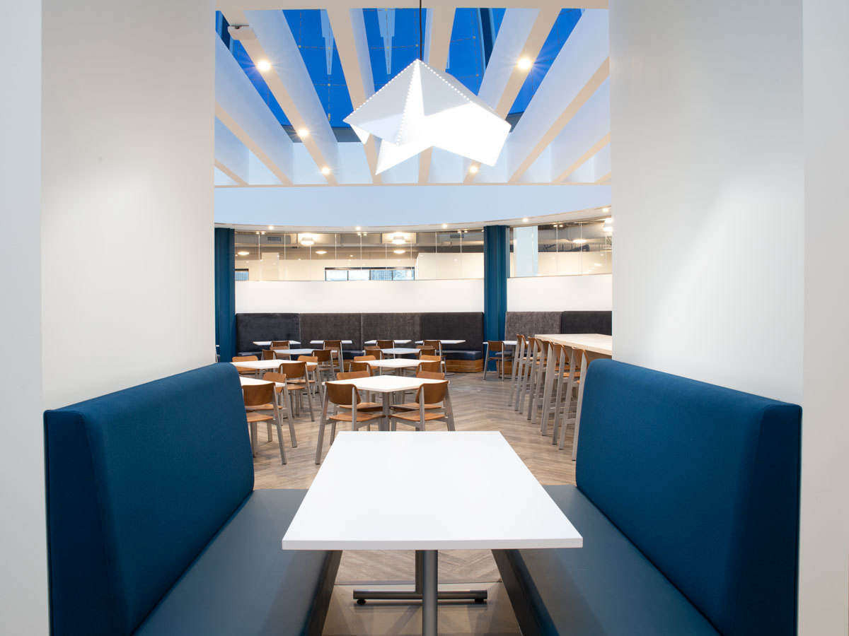 Cozy nooks are available for eating, working, collaborating and socializing in the break room and common area of the YMCA association headquarters in Minneapolis, Minnesota.