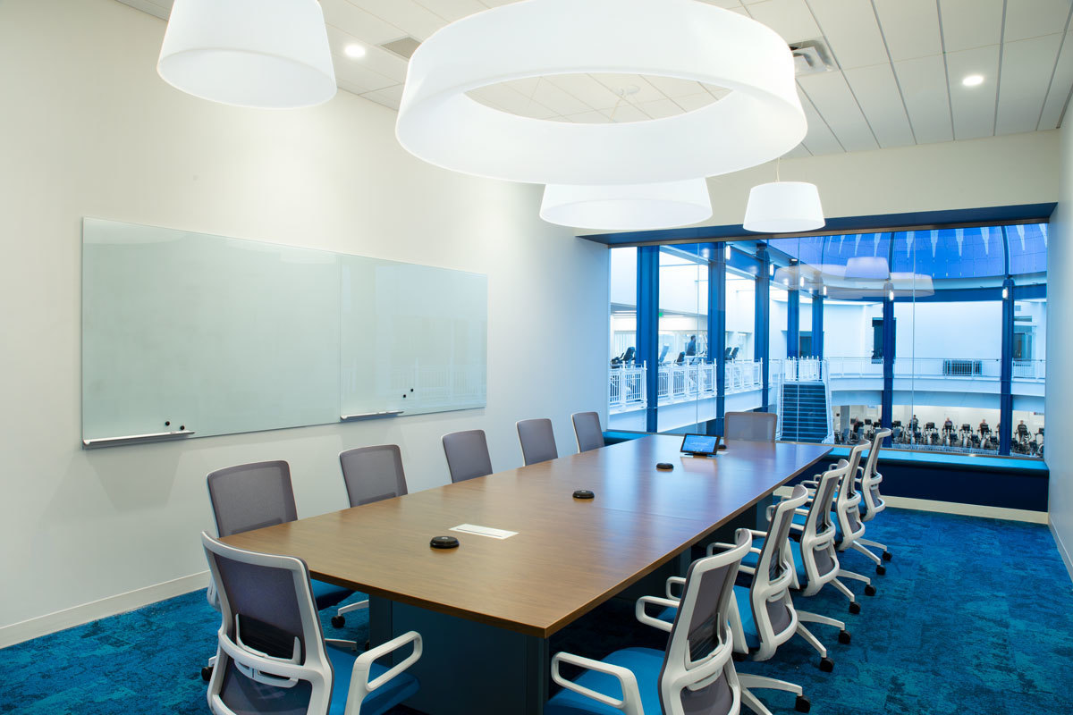 A large conference room overseeing the atrium at the YMCA headquarters in Minneapolis, Minnesota, using furniture provided by iSpace Environments.
