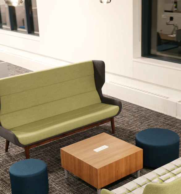 Soft seating can be accessed throughout the workspace, making it easy to shift from desk to more relaxed seating.