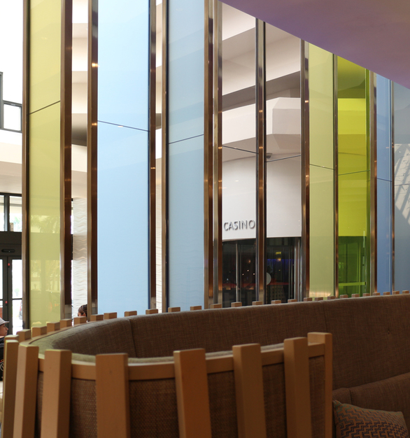 Bendheim's multi-colored decorative laminated glass wall serves as a functional art piece at the Renaissance Jaragua Hotel by Monolayer Design. Photo by Anna Lorente.