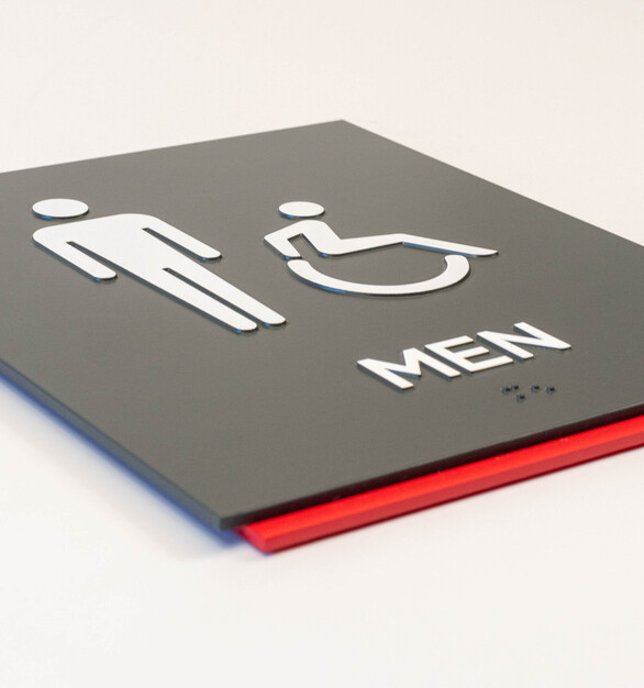 White copy on a dark grey acrylic sign with a red backpiece by Welch Sign.