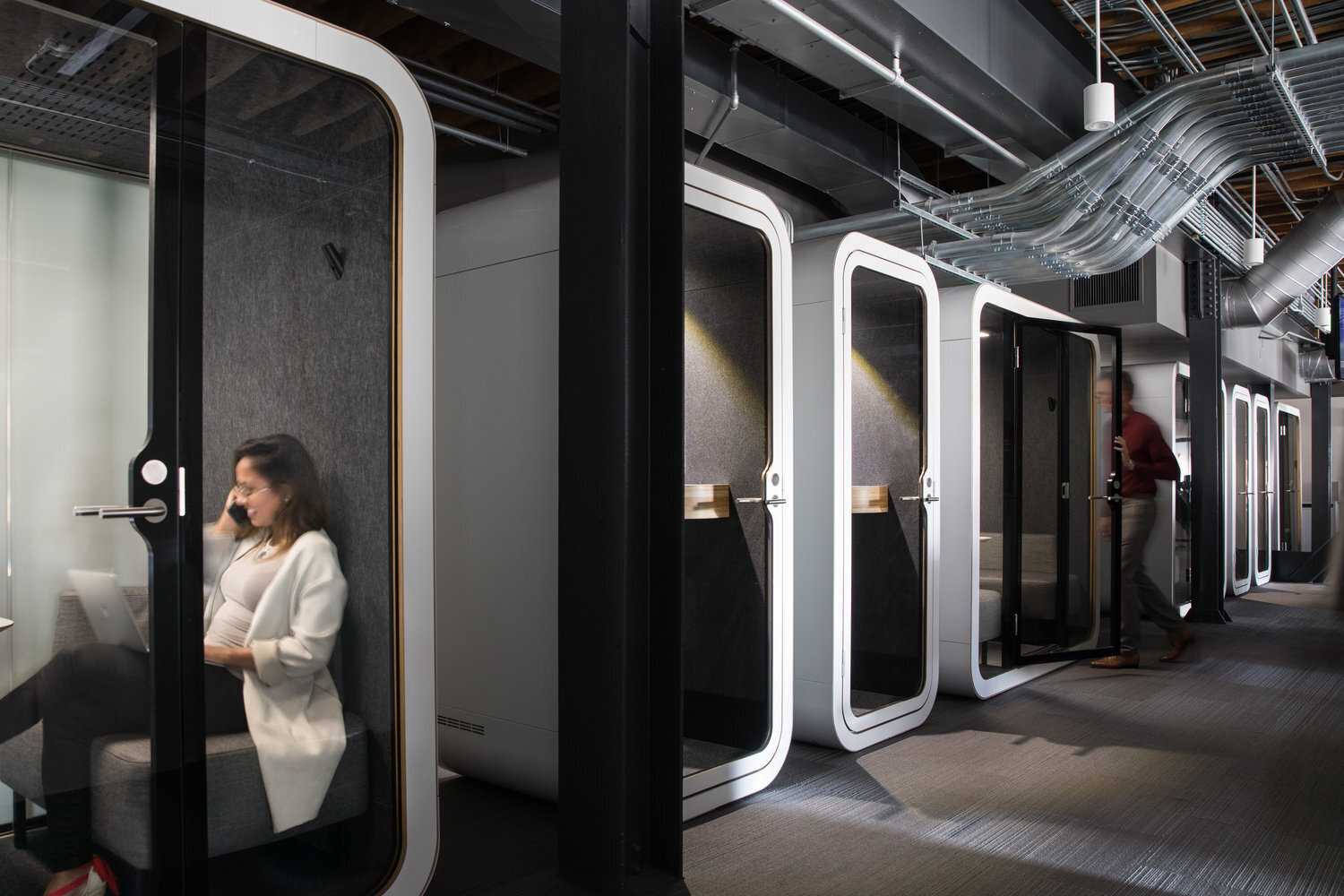 Private phone booths allows you to be efficient and focused at the Jackson Square Office expansion in San Francisco, California, by Jennifer Tulley Architects.