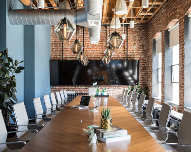 A comfortable large conference room environment encourages collaboration and teamwork at the Jackson Square Office expansion in San Francisco, California, by Jennifer Tulley Architects.