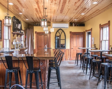 A mix of old and new. The interior space of Chapel Brewing features original pieces as well as updated architectural elements by Joy Martin Architecture.