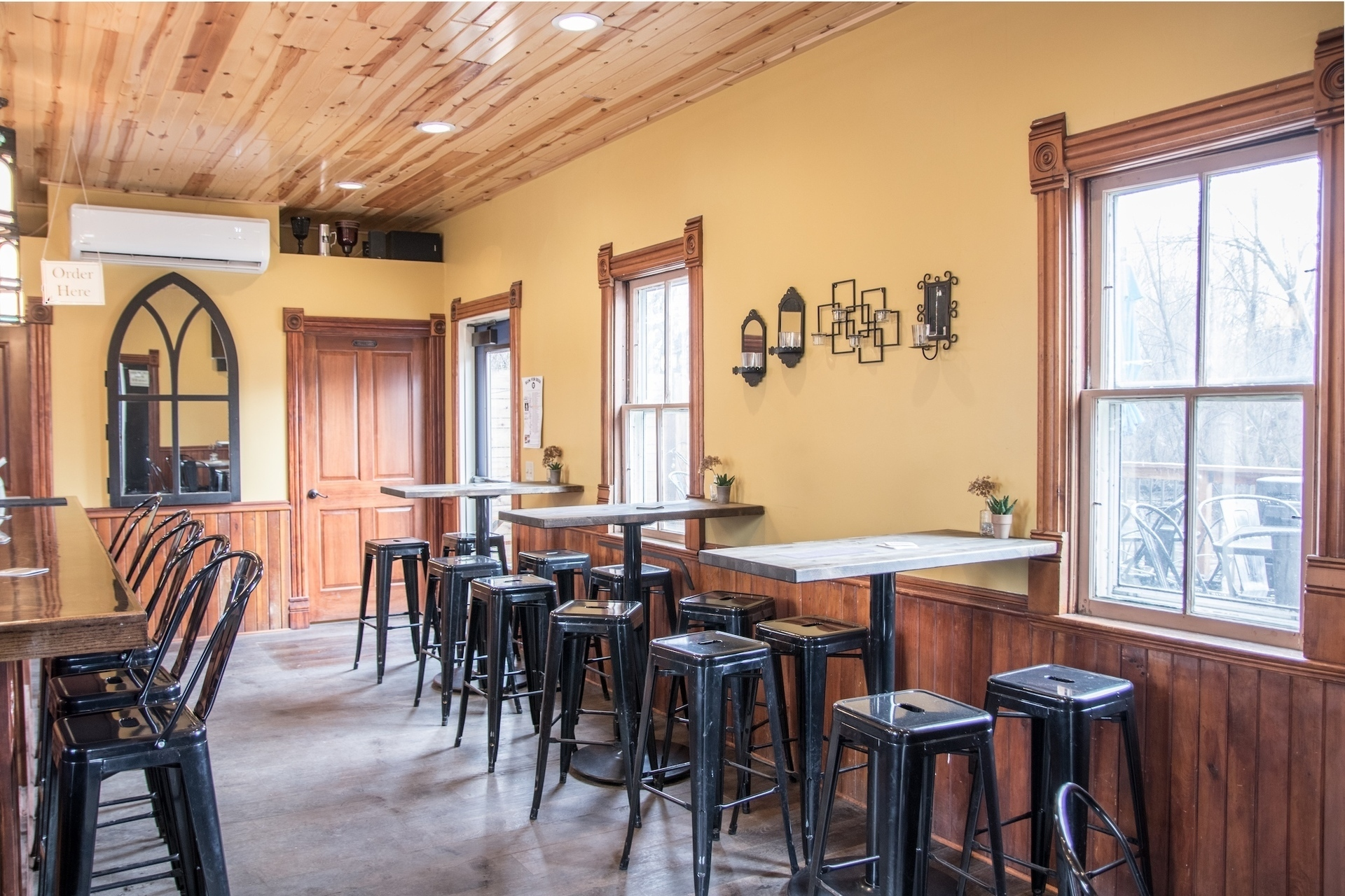 The welcoming interior of Chapel Brewing in Dundas, Minnesota, by Joy Martin Architecture.
