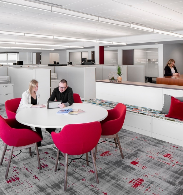 The open office lighting utilizes the Fluxwerx View to provide indirect/direct illumination for all personal and collaboration work areas. The fixtures are part of the daylighting system that seamlessly dim to a lower output when adequate daylight is available in the open office. This allows for energy savings while providing the employees great access to daylight.