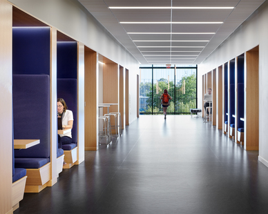 The spacious common area at the Janet Wallace Fine Arts Center incorporates lighting and control systems provided to JTH Lighting.