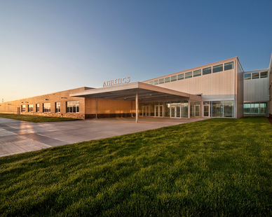 "The sprawling campus with room for 3,000 students is broken down into a handful of more intimate, human-scale learning spaces, called ""think tanks"". Lighting up Metea comes largely from the extensive use of Kalwall® translucent curtain wall.