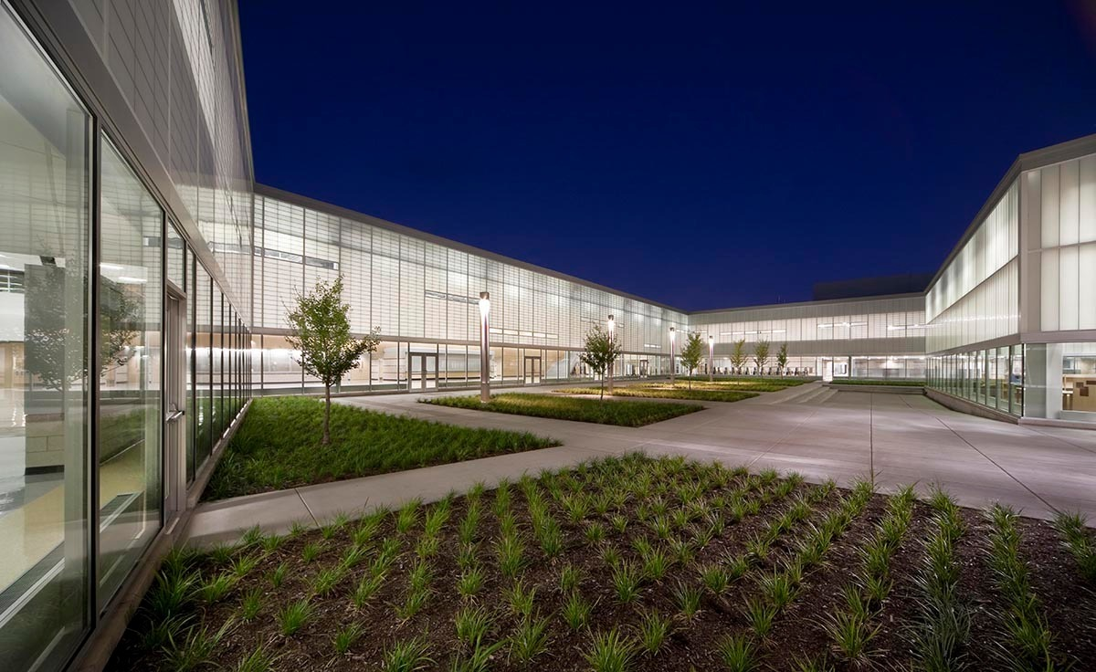 """From the beginning, architects DLR Group designed Metea Valley High School in Aurora, Illinois, to light up education, both literally and figuratively. The sprawling campus with room for 3,000 students is broken down into a handful of more intimate, human-scale learning spaces, called """"think tanks"""", where interaction with faculty is encouraged.  Photo credit: James Steinkamp Photography"""