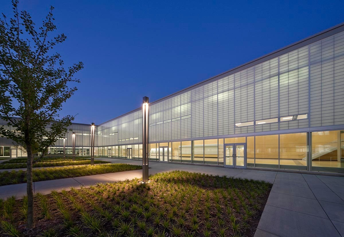 Two interior courtyards, open to the sky, offer fresh air during free periods. Shaped a bit like a bow tie, Metea combines three concepts – mind, in the midsection, and body and soul on either end – to offer students 21st-century school experience.  Photo credit: James Steinkamp Photography