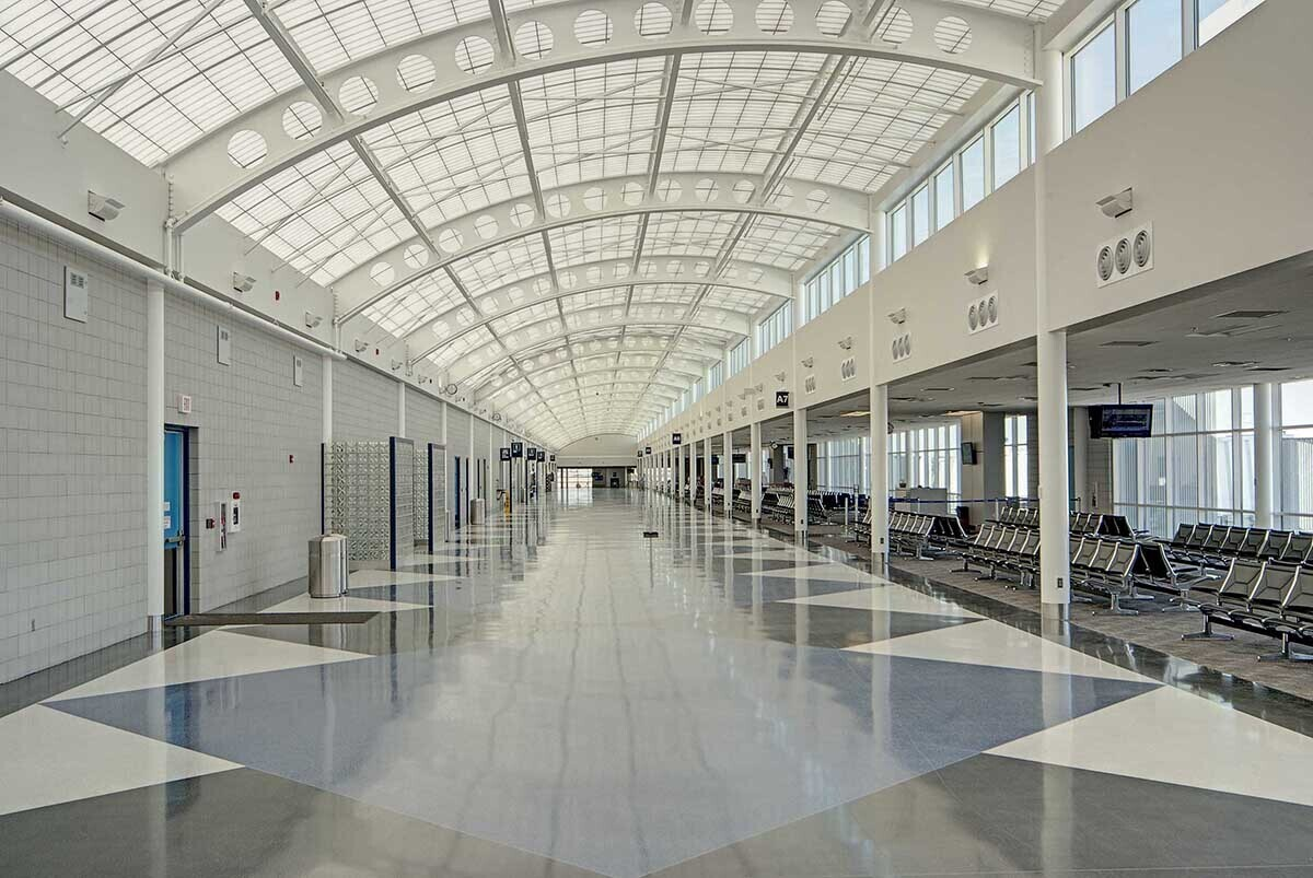 Construction took place in three phases over a 2-year period in order to allow the airport to operate with the uninterrupted operation of all flights. The Kalwall Skyroof significantly contributed to this effort, as systems are pre-engineered and factory pre-fabricated for rapid installation. This speeds the construction process, lowers costs, and results in leakproof, trouble-free installation.  Photography by: Abstract Photography, Inc.