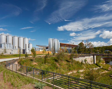 The New Belgium Brewery in Asheville, the company's first on the East Coast, is a great example. The project earned three LEED Certifications: Silver for the Distribution Center, Gold for the Brew House, and Platinum for the Liquid Center. Plus, it was designed to be a vibrant workplace that encourages collaboration by using natural daylight to take advantage of the brewery's open floor plan and picturesque views of the French Broad River. The architects, the international firm of Perkins + Will, also successfully incorporated the brewing equipment into their design.