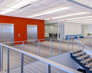 Office staircase and cable railing system by Keuka Studios.
