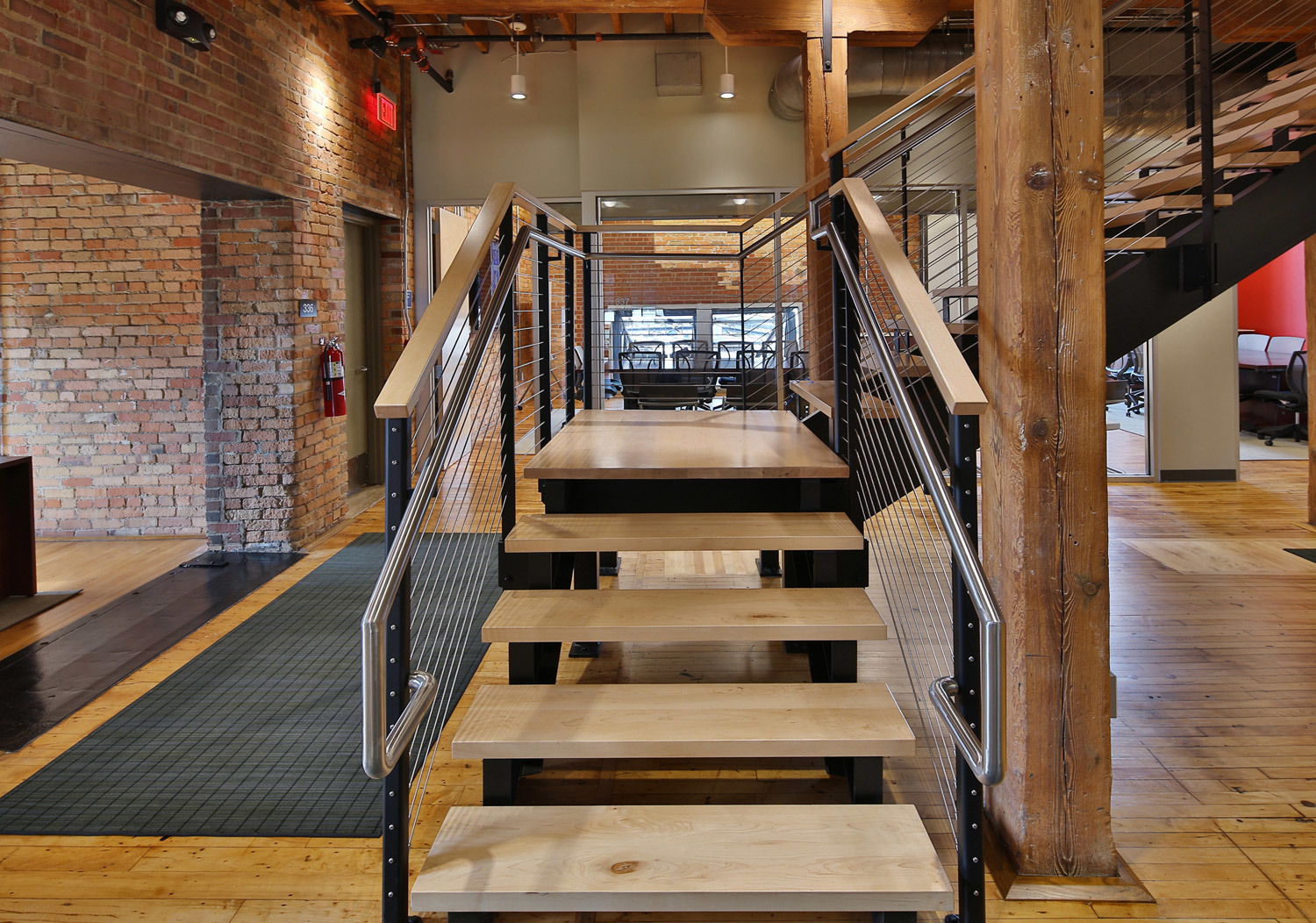 A modern cable railing system for an office floating staircase.