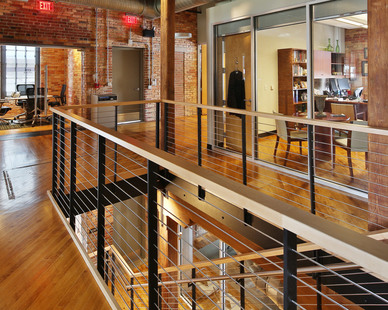 Industrial style office with a Keuka Studios cable railing system.