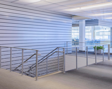 Modern cable railing system for office interior.