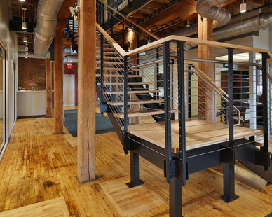Keuka Studios Ithaca Style cable railing system with a maple top rail.