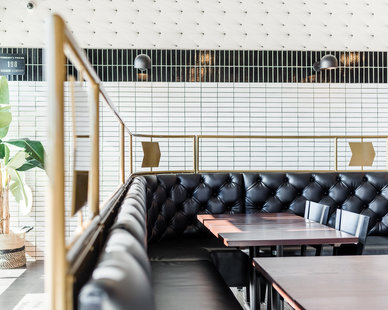 Various banquette seating options are available throughout the restaurant for guests. The different finishes create a fun and inviting atmosphere.