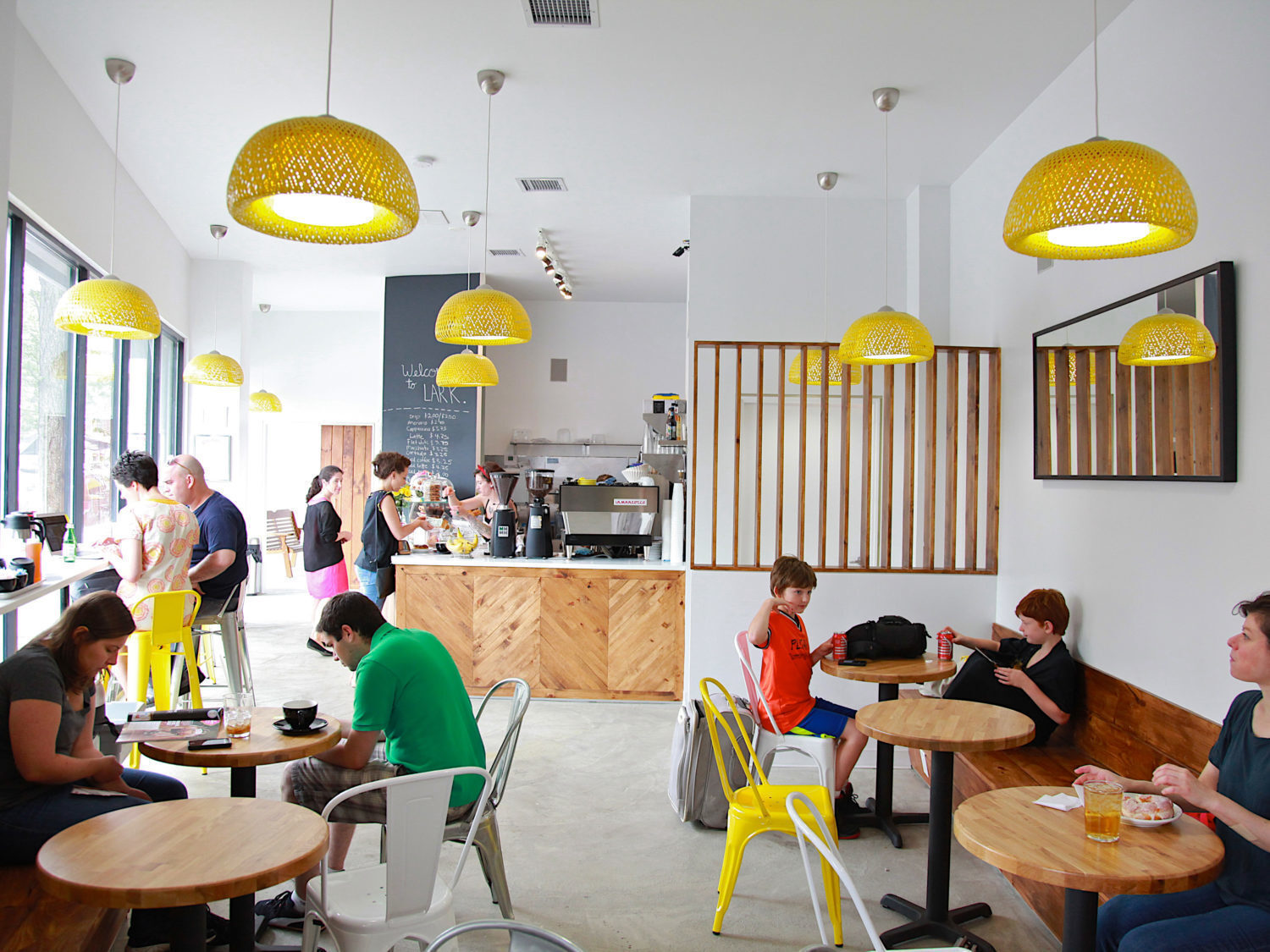 The first thing you see upon entering Lark is a field bright of bright yellow lights that create a dominant plane throughout the space. This main design element helped achieve one of the clients esthetic goals to incorporate pops of color that would be inviting to children and their parents promoting the idea behind the family friendly coffee house.
