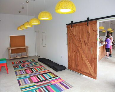 Visual continuity was maintained between the two spaces by creating a large opening in the wall dividing the spaces and installing a very large sliding barn door that could be closed off completely during private events.