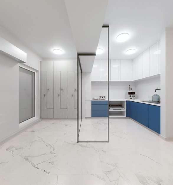 Small kitchen space within this healthcare setting features Durasein's solid surface material in White Oat and Grigio.