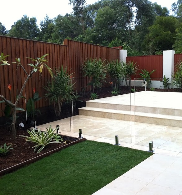 Beautiful vertical fencing next to a pool used for privacy.