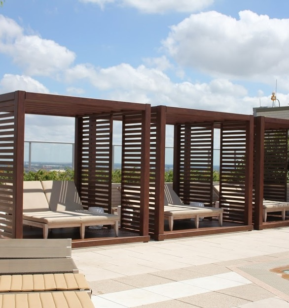 Lounge by the pool under this beautiful pergola.