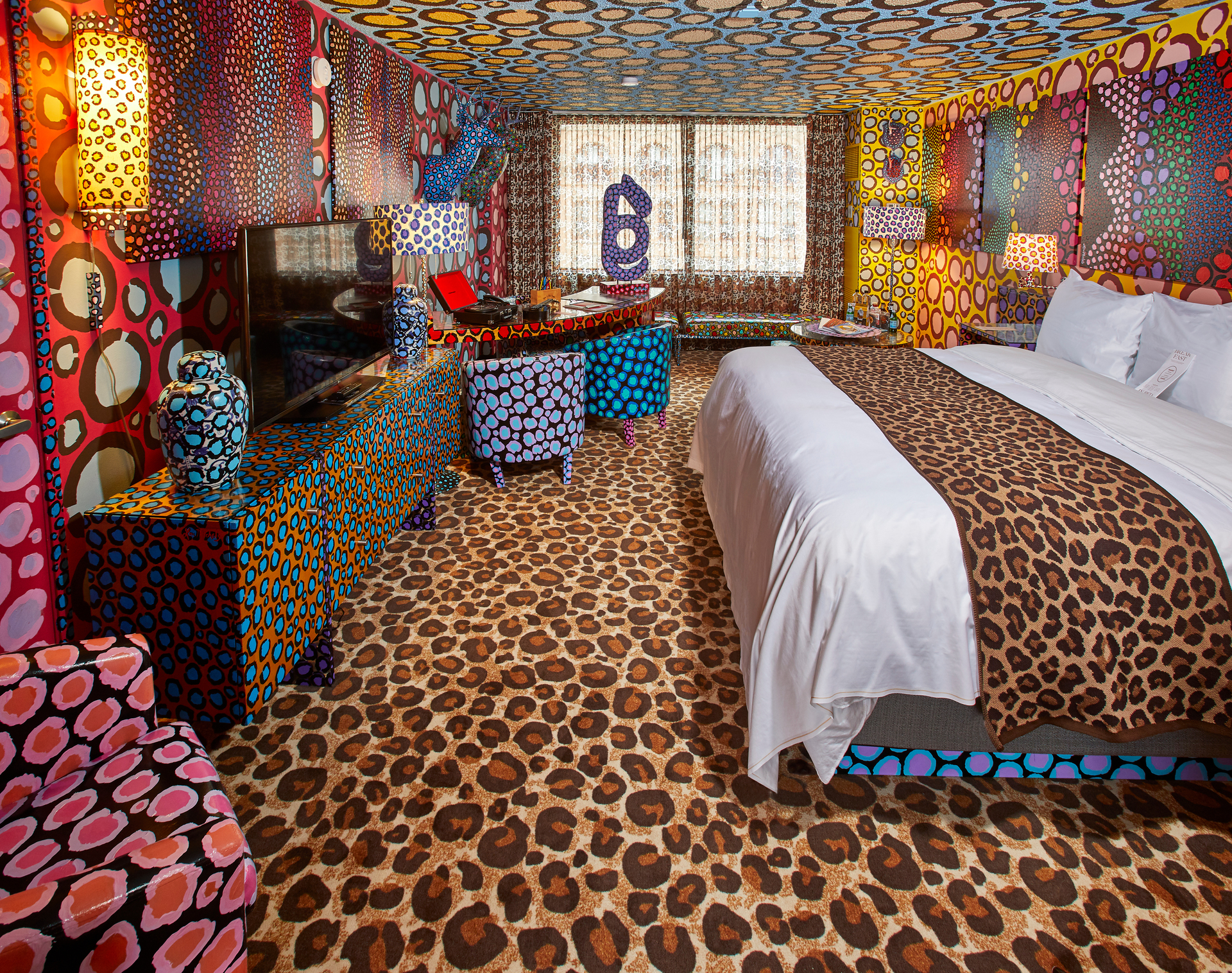 Five of the hotel's guest rooms are designed entirely by local artists, like the Leopard Room by Lon Michaels.