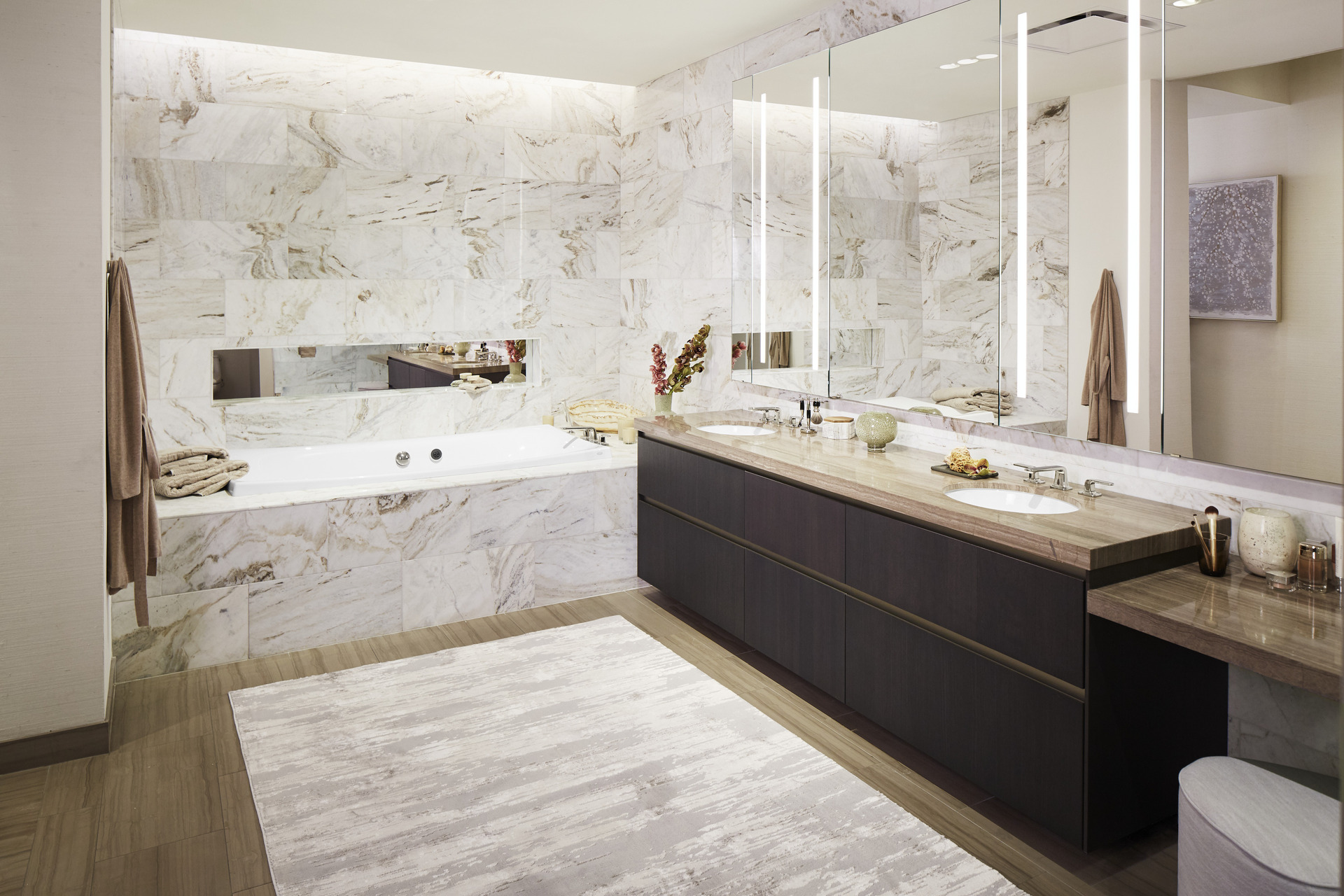 Residence packages are designed to emulate the Tower's exterior and feature the finest fixtures and finishes from KALLISTA and Kohler. The luxurious bathtub and double-bowl, stainless steel sinks designed by Kohler and faucets and accessories designed by KALLISTA leave both the bathroom and kitchen feeling refined and polished.