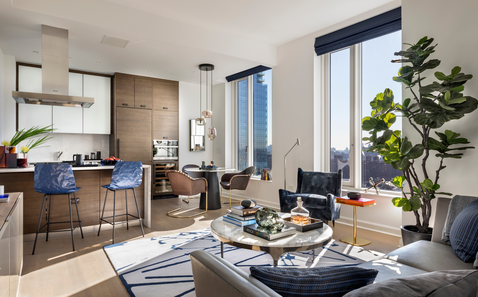 Natural light fills the living area in an apartment unit at One Hudson Yards in New York, New York. To execute the vision of the space, Andre Kikoski chose unique materials from artisans and craftsman all over the world and bespoke products from the finest manufacturers in the industry — including a collaboration with KOHLER on bathroom products.