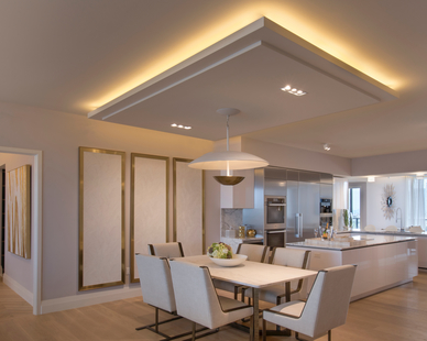 An elegant open-concept unit with modern fixtures and warm undertones at Privé at Island Estates in Miami, Florida.