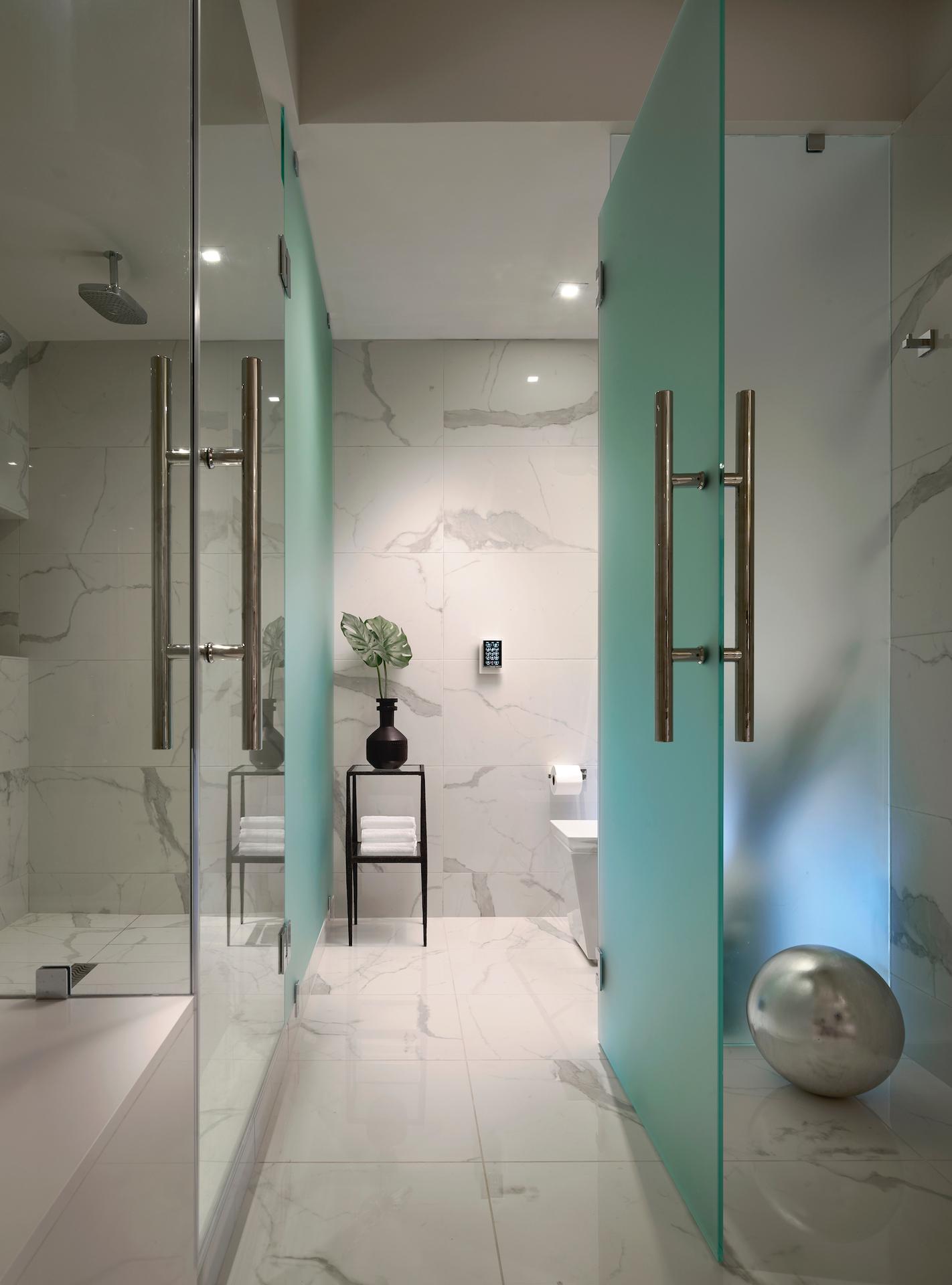A master bathroom design featuring marble materials that creates an elegant, modern feel at Privé at Island Estates in Miami, Florida.