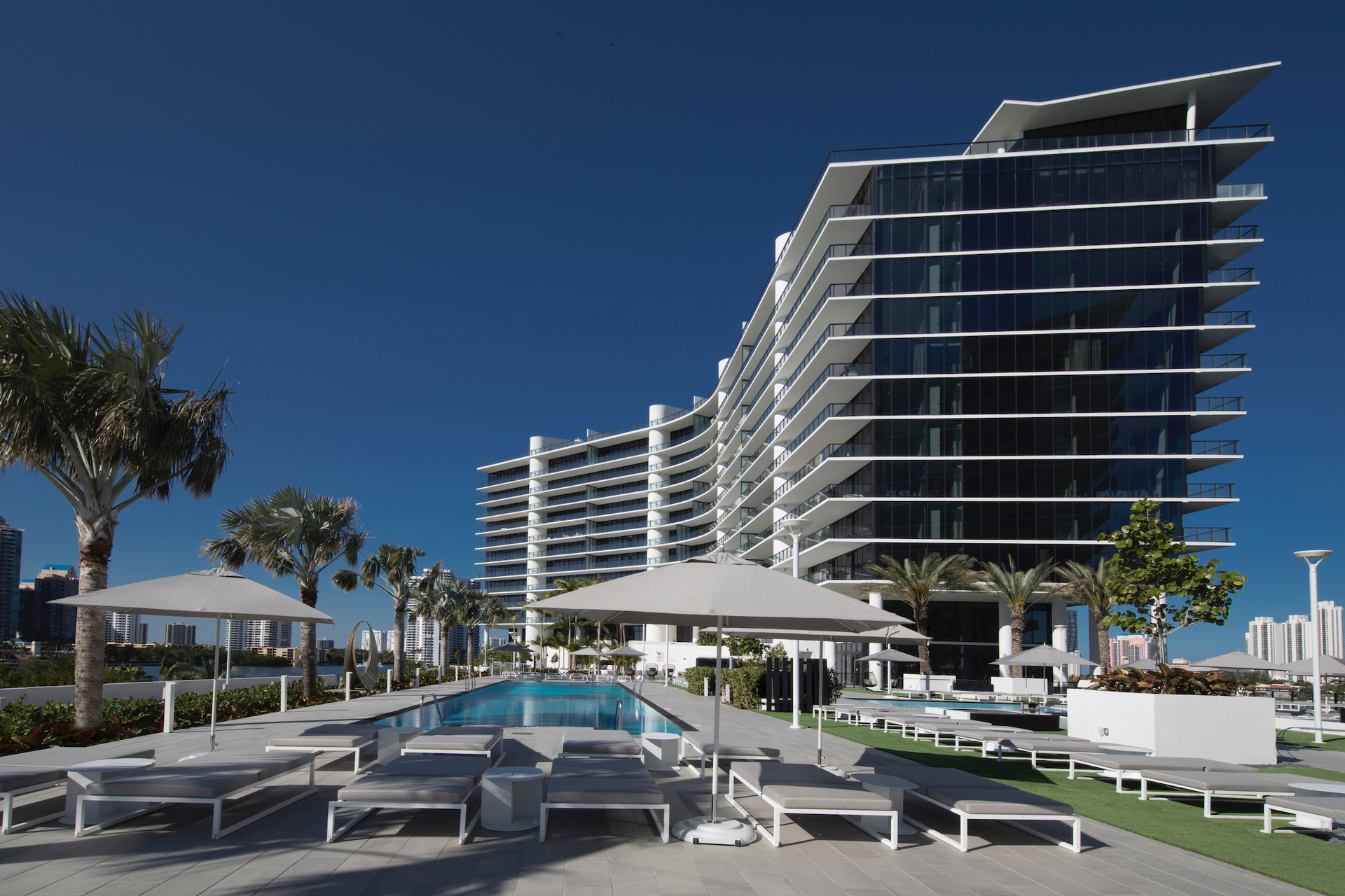 Privé at Island Estates' exterior incorporates a clean design with bold lines and glass walls for guests and tenants to enjoy.