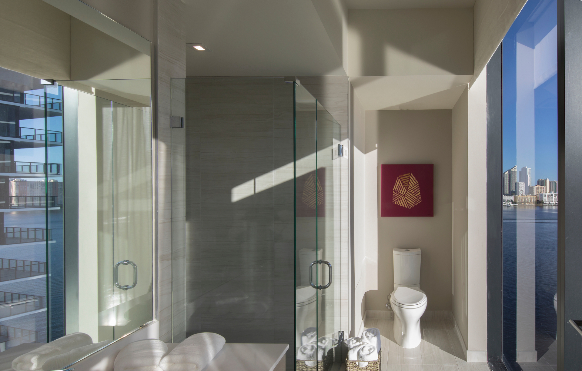 A beautiful unit bathroom with a view at Privé at Island Estates in Miami, Florida.