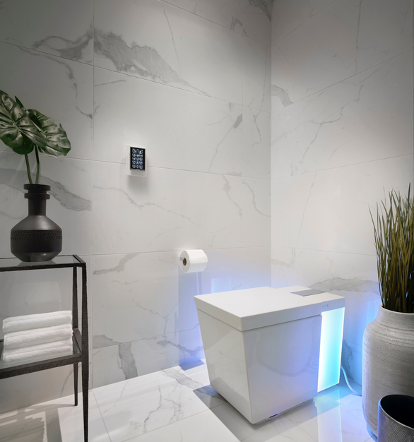 A modern bathroom featuring Numi® by Kohler, a toilet that combines unmatched design and technology to bring you the finest in personal comfort and cleansing.