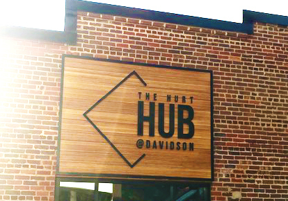 Located in Davidson, North Carolina, The Hurt Hub at Davidson College features Lamboo® Rainscreen™ - Exterior Cladding, along with commercial signage.