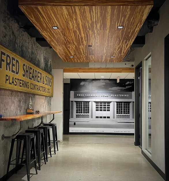 Featured here at Fred Shrear & Sons, Lamboo® Skyline™ Ceiling Systems, custom tiger strand ceiling cloud.