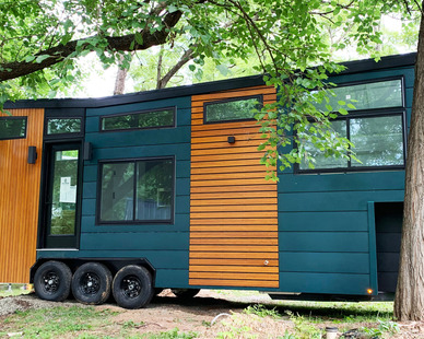 Featured here is the Greenwood Tiny Home. The home features Lamboo® Elements™ - Exterior Components.