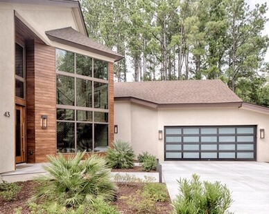 Hilton Head Residence features Lamboo® Rainscreen™ - Exterior Siding/Cladding throughout the exterior of the home.