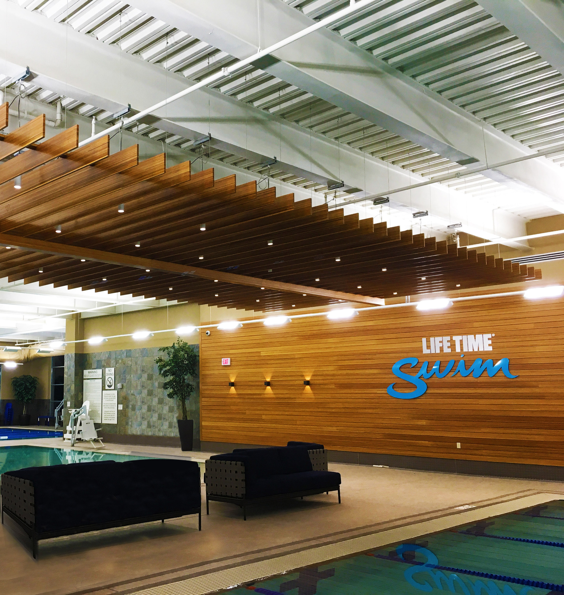Featured here at Lifetime Fitness is the combination of Lamboo® Skyline™ - Custom Ceiling Trellis & Lamboo® Rainscreen™ - Interior Feature Wall.