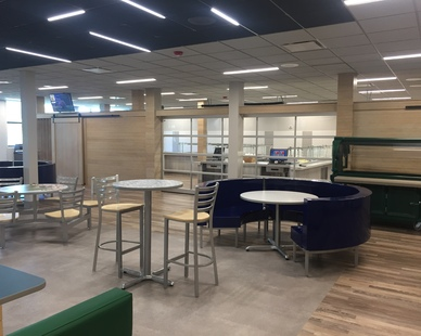 Throughout the cafeteria at McComb High School Lamboo® Surface™ - Wall Paneling is featured.