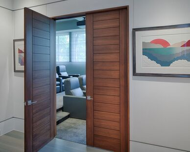 Featured in the interior of the Okatie Residence, the use of Lamboo® Vue™ - Interior Doors is seen.