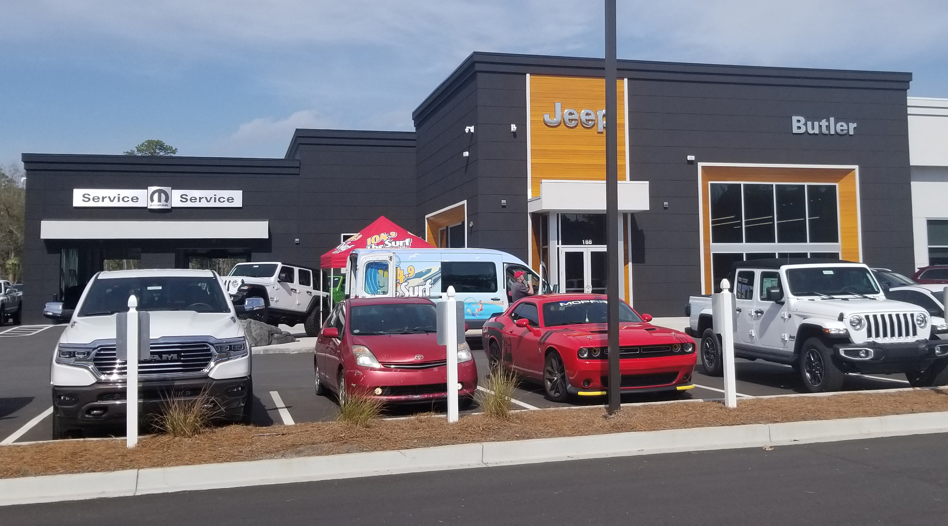 Featured here at Butler Automotive Dealership are Lamboo® Rainscreen™ Siding & Soffit Systems.